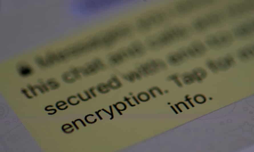 An encryption message is seen on the WhatsApp application on an iPhone