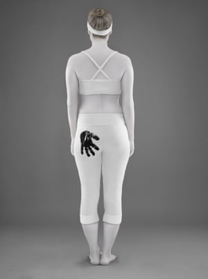 woman in white with black handprint on her bottom