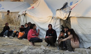 Syrian people who were displaced by a Turkish military operation are seen in 2019.