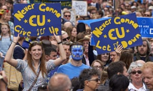 Protesters hold pro-EU placards on the March for Europe.