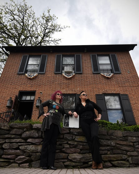 Jenny Thomas (left) and Brigid Goode, Gettysburg ghost hunters, stand in front of Farnsworth House.