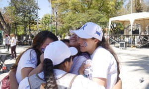 Brisa De Angulo embraces young women who are beneficiaries of her charity in Cochabamba, Bolivia.