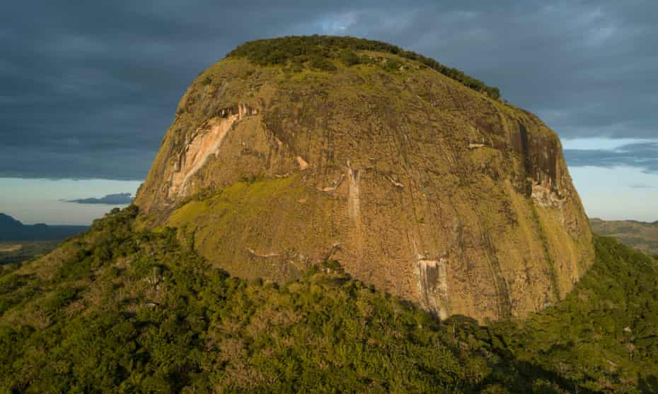 The Western Face of Mount Lico rises 700 metres above the surrounding plain. Mountains that rise alone like this are called inselbergs. Mozambique has hundreds