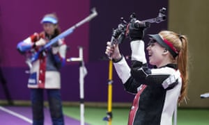 Nina Christen of Switzerland, reacts after the last shot in the women's 50-meter 3 positions rifle at the Asaka Shooting Range in the Tokyo Olympic Games.