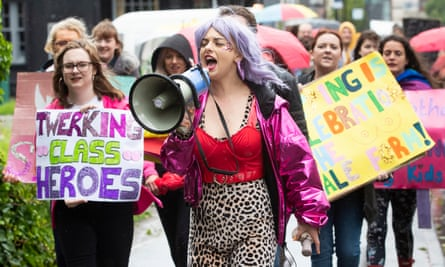 Strip club dancers march through Sheffield to oppose moves to close a branch of Spearmint Rhino.