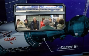 Commuters on a space-themed train at Polezhayevskaya station in Moscow. The metro makeover marks the 55th anniversary of the first manned space flight, by Yuri Gagarin on 12 April 1961