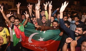 Khan supporters celebrate the predicted result after a bloody election day that saw dozens killed in separate bomb and shooting attacks.