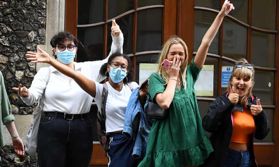 Students outside the Department of Education celebrate a government U-turn