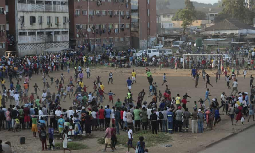A crowd watches an informal football match in a Harare township. The pandemic hit before professional clubs could begin the new season in 2020.