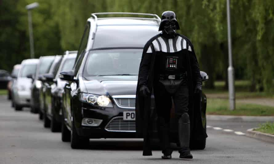 A funeral director dressed as Darth Vader