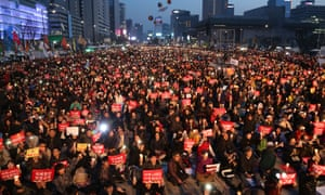 Demonstrators gather in Seoul on Saturday night for a candlelit rally to celebrate former president Park Geun-hye's ouster.
