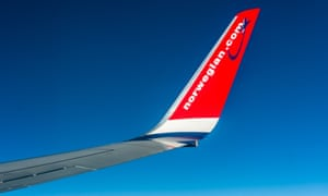 Winglet of Boeing 737 of Norwegian in mid-air.