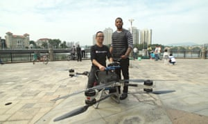 Ready for take-off: Reggie Yates in China with Zhao Deli, inventor of the 'Magical Cloud' flying motorbike.
