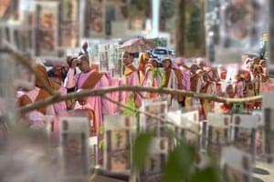 Yangon, MyanmarNovice nuns walk through cash donations during Buddhist religious festivities.