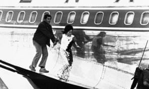 A bloodstained Theresa Halsa leaves the plane on 9 May 1972