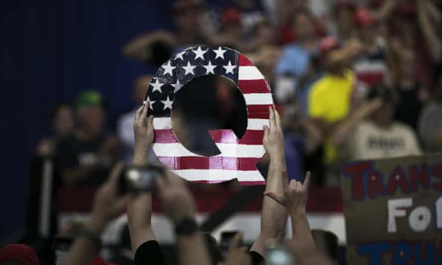 Q sign at a Trump rally