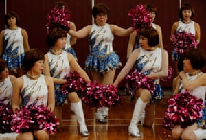 Tokyo, Japan. Fumie Takino, 89, the founder of a senior cheer squad called Japan Pom Pom, pictured with other members of the squad