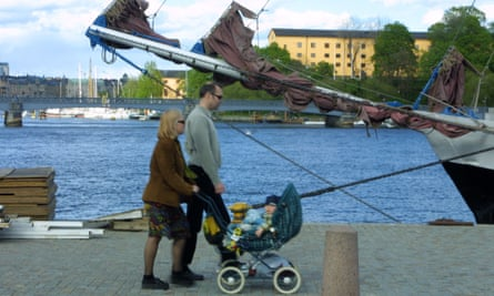 A Swedish couple walking their baby in Stockholm.
