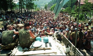Dutch UN peacekeepers watch Muslim refugees from Srebrenica, eastern Bosnia, gather in the nearby village of Potocari in July 1995.