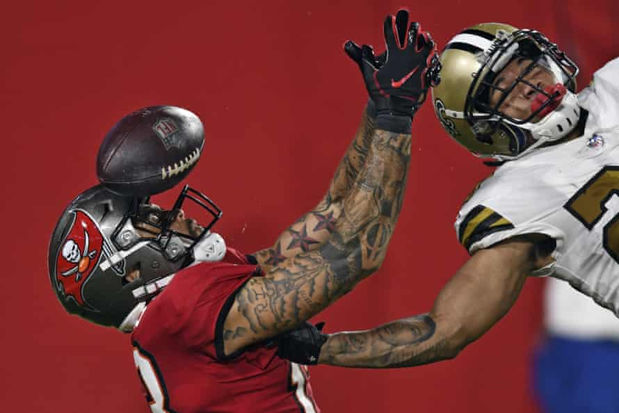 New Orleans Saints cornerback Marshon Lattimore knocks the ball away from Tampa Bay Buccaneers wide receiver Mike Evans during the second half of their NFL game in Tampa on 8 November.