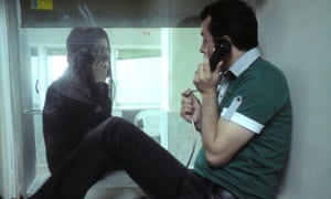 Ahmadian speaking to his wife, Hedayat, through a cabin in Tehran's Evin prison.