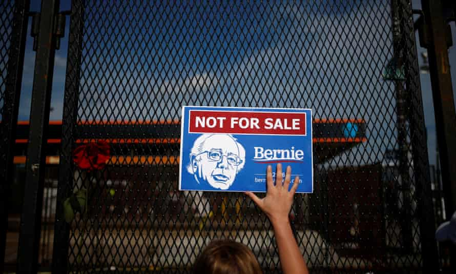 Supporter of Bernie Sanders holds placard at perimeter walls of 2016 Democratic National Convention in Philadelphia.