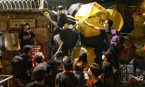 Protesters build a barricade to block the entrance of the Wan Chai police headquarters in Hong Kong.