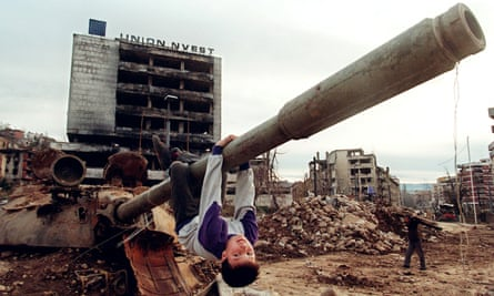 A boy playing on a tank in the Sarajevo neighbourhood of Grbavica, April 1996.