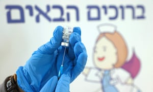 An Israeli health worker of the Maccabi Healthcare Services prepares to administer a dose of the Pfizer-BioNtech coronavirus vaccine on 24 February 2021 in Tel Aviv.