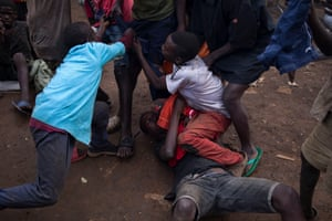 Children fight over a pair of jeans in Kisenyi.