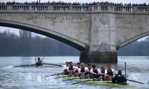 The Cambridge crew, left, celebrate their victory as Oxford trail home.