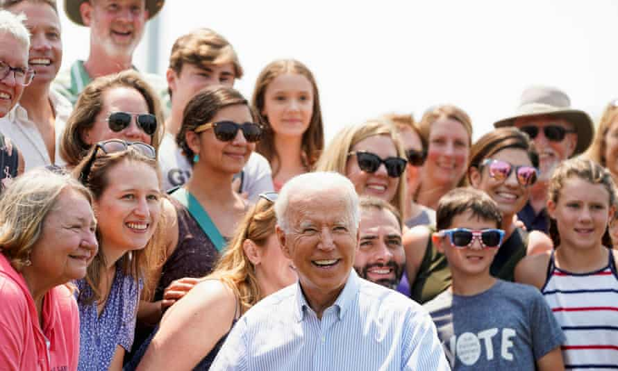 Biden poses with supporters after touring King Orchards farm in Central Lake, Michigan.
