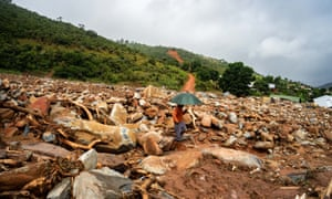 An elderly man walks through the rubble of destroyed buildings in Chimanimani in Zimbabwe.