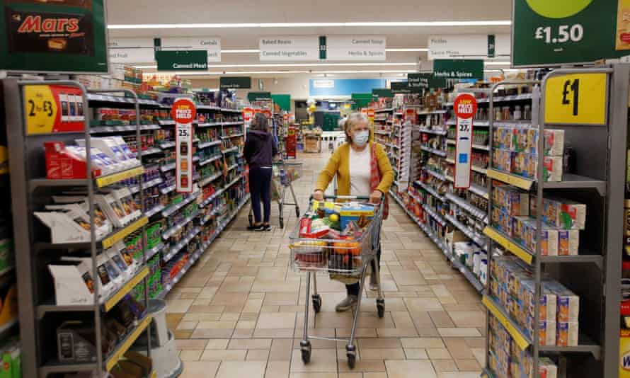 A customer wearing a face in a Morrisons supermarket