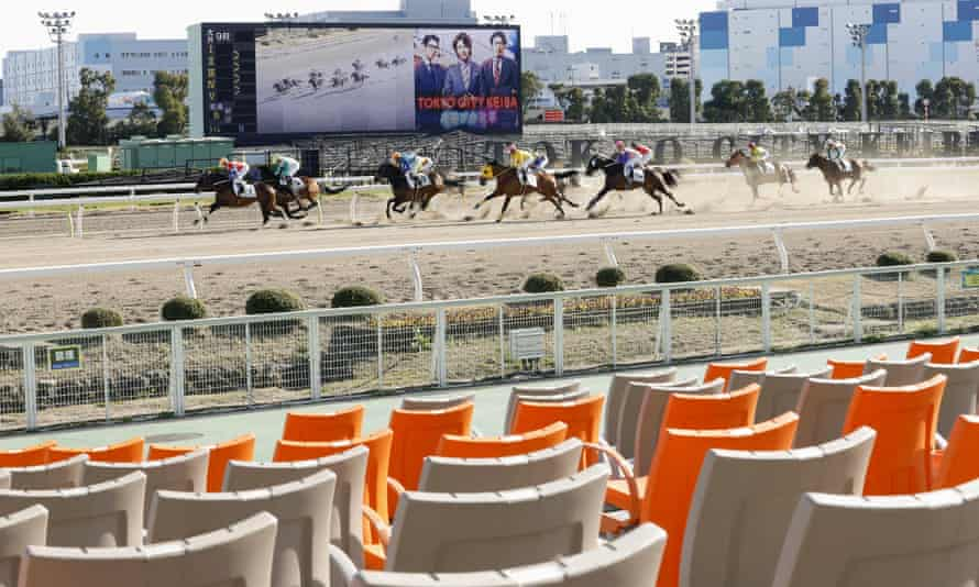 A race meeting is held without spectators at Oi course in Tokyo in February.