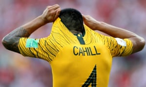 Whilst Australia's Tim Cahill looks dejected.