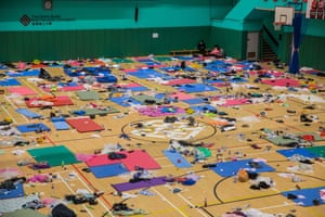 Protesters rest inside a sports hall at Hong Kong Polytechnic University in the Hung Hom district on 21 November, 2019.