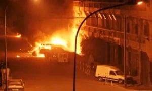 Vehicles on fire outside the Splendid Hotel.