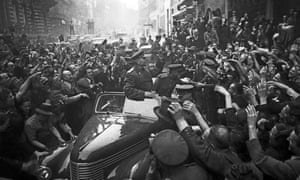 Marshal Konev is welcomed by residents in Prague after the city's liberation from German troops in 1945.