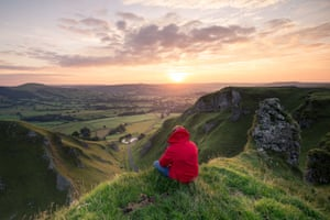 A beautiful orange and red sunrise greets visitors on the morning of bank holiday Monday, Winnats Pass, Derbyshire, UK