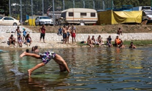 A boy dives into the Bjelica river in Guca, Serbia, 10 August 2017, as the Lucifer heatwave continues with temperatures in Serbia reaching 38C.