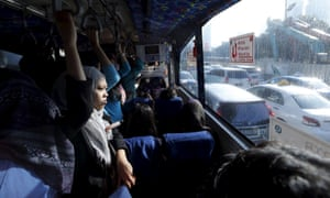Passengers on a bus in Jakarta.