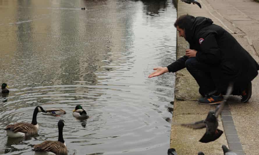 Man feeding ducks