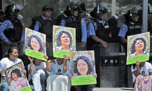 Human rights activists take part in a protest following the murder of Berta Cáceres
