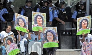 Human rights activists take part in a protest to claim justice for Berta Caceres