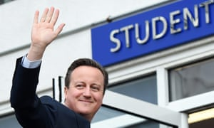 David Cameron waves to school children at the Harris academy school in London this week.