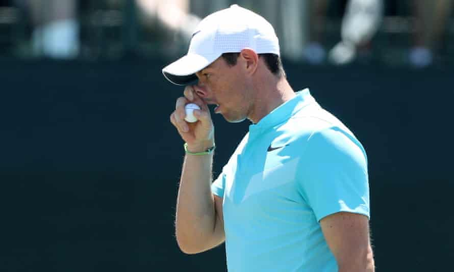 Rory McIlroy leaves the green on the par-three 9th, his final hole after missing the halfway cut.