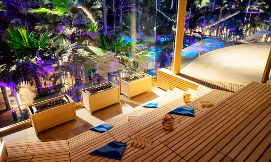 sauna with huge picture windows over pool