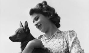 Princess Elizabeth with her first pet corgi, Susan, at Windsor Castle in 1944.