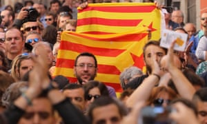 Protesters in Madrid carry Catalan separatist flags during a rally in favour of a planned referendum on independence.